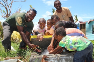 Children and villagers of Malake Island off Rakiraki at their water flush-out point. The islanders are among other villages in the Ra province to have received normal water supply